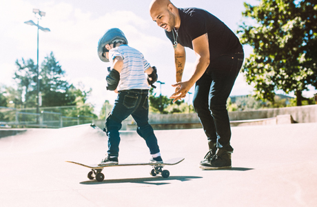 dad and son skateboarding